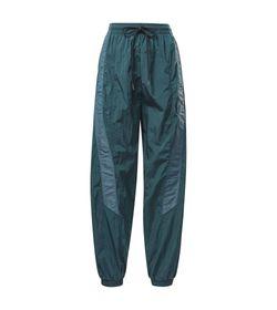 Pantalon-reebok-para-mujer-Sh-Q1-Woven-Pant-para-entrenamiento-color-verde.-Frente-Sin-Modelo